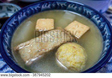 Close-up Of A Bowl Of Simple Homemade Japanese Oden Soup, Contsisting Fish Cakes And Fish Balls, And
