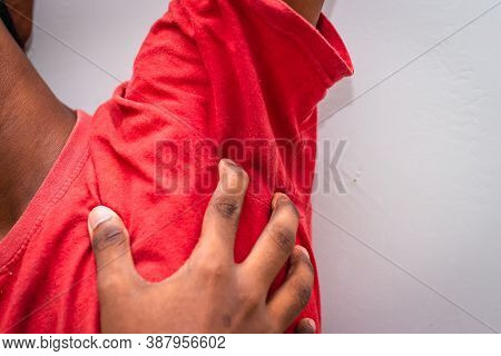 Itching Of Skin Diseases - Man Uses His Hand To Scratch The Armpit For Itch Skin. Not Something To D