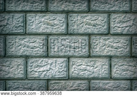 The Wall Of The Building Is Made Of Concrete Blocks. Aged Blue And Green Tinted Background Or Wallpa