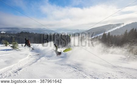 Skiing Racing Down From High Mountain. Skier Making Unlucky Maneuver On Turning And Falling On Snow.
