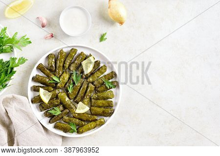 Dolma, Stuffed Grape Leaves With Rice And Meat On Light Stone Background With Free Text Space. Top V
