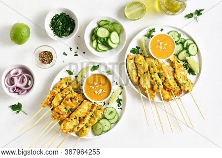 Chicken Satay With Peanut Sauce. Grilled Chicken Skewers Served With Peanut Dipping Sauce. Tasty Mea