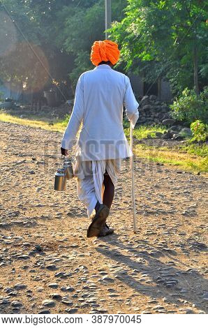 An Old Man Walking Alone With His Loneliness