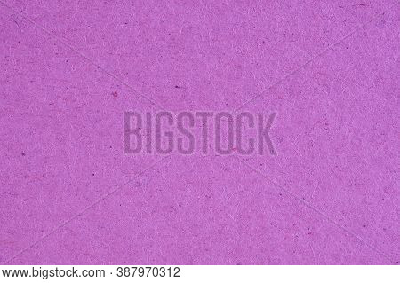 The Surface Of Purple Lilac Cardboard. Rough Natural Paper Texture With Cellulose Fibers. Bright Sat