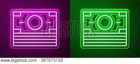 Glowing Neon Line Stacks Paper Money Cash Icon Isolated On Purple And Green Background. Money Bankno