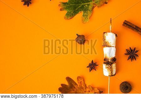 Christmas Composition. Cinnamon Marshmallows Leaves And Anise On Yellow Background. Fall Composition