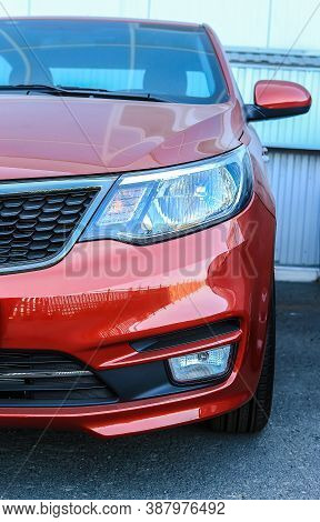Modern Red Car Front View Closeup Photo