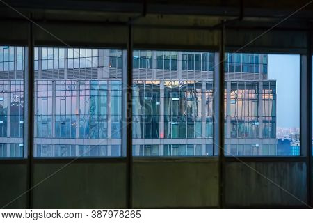 Modern Skyscraper With Glass Facade From The Window Of The Building Under Construction