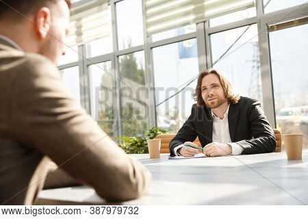 Interviewer Is Questioning A Candidate On A Job Interview