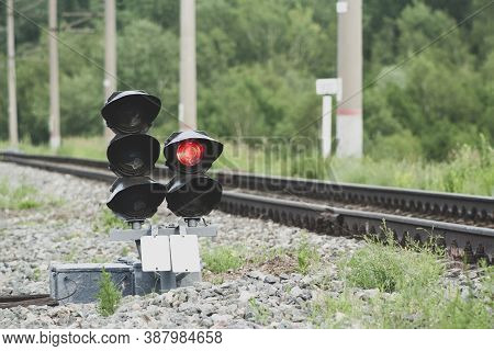 Traffic Light On Railroad Tracks Close-up. Movement Of Trains And Freight Trains. Railway
