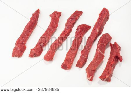 Beef Steak Cut Into Strips On White Background
