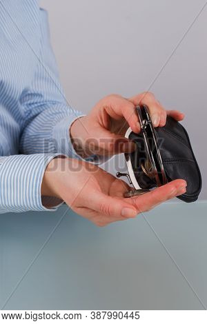 Leather Purse With Coins In Female Hands. Famale Hands Taking Coins From Purse. Lack Of Money.