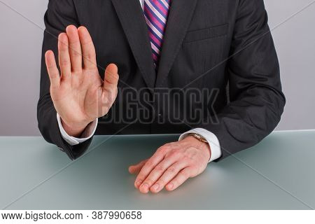 Close Up Businessman Showing Stop Gesture With Hand. Businessman Saying Stop Holding His Hand In Fro