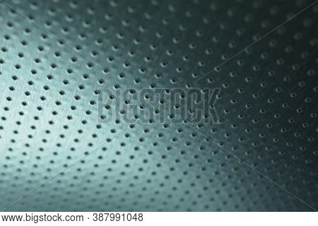 Dark Metallic Wallpaper. Tinted Blue Or Green Background. Perforated Aluminum Surface With Many Hole