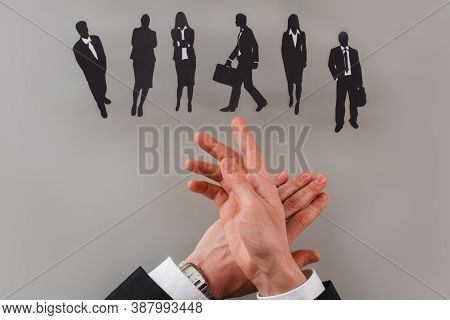 Businessman Choosing The Best Candidate For A New Employee. Hiring Candidates To Company.