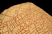 Written in stone by Vikings: The Rik rune stone from the 9th century features the longest known runic inscription - 760 characters. poster