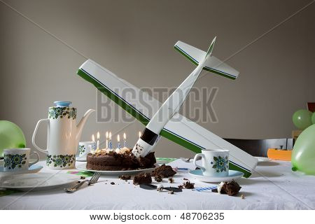View of a airplane model flown into birthday cake