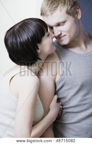 Romantic young couple rubbing noses
