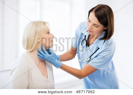 healthcare, medical and plastic surgery concept - plastic surgeon or doctor with patient