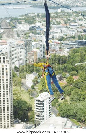 Man Hanging On Ropes From Skytower In Auckland