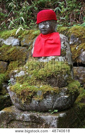 Nikko Japan - jizo statue at famous Kanmangafuchi. Jizo also known as Ksitigarbha are bodhisattvas in East Asian Buddhism. poster