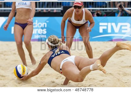12/08/2011 LONDON, ENGLAND, April Ross (USA) ives for the ball as   Lisa Rutledge (USA) looks on during the FIVB International Beach Volleyball tournament, at Horse Guards Parade, Westminster, London.