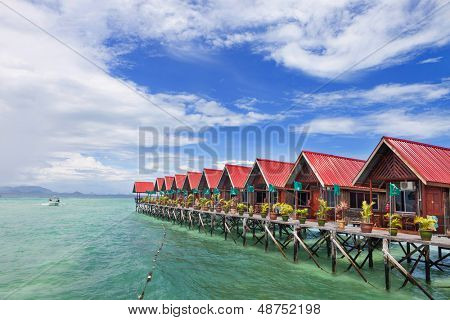 Over water bungalow with bule sky