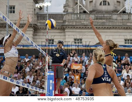 12/08/2011 LONDON, ENGLAND, Lucy Boulton & Denise Johns (GBR) vs Heather Bansley & Elizabeth Maloney (CAN) during the FIVB Beach Volleyball tournament, at Horse Guards Parade, Westminster, London.