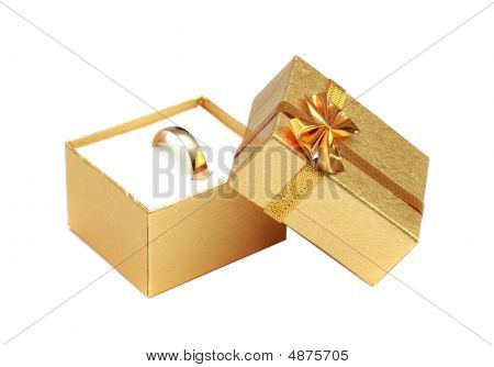 Golden Ring In Gift Box Isolated On White