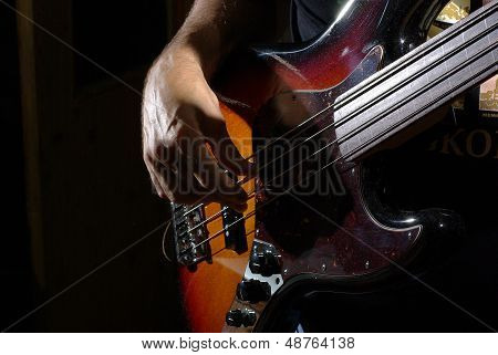 Man playing an bass guitar