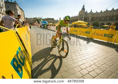 KRAKOW, POLAND - AUGUST 3: Unidentified participant of 70th Tour de Pologne cycling 7th stage race, August 3, 2013 in Krakow, Poland. Tour de Pologne, the biggest cycling event in Eastern Europe.