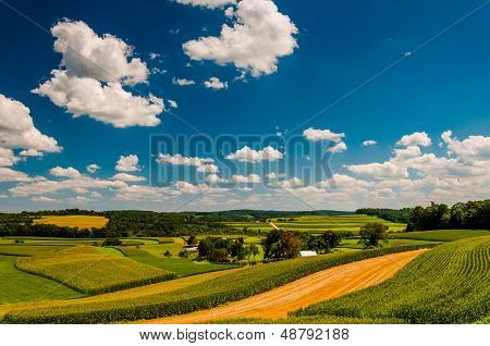 Beautiful Summer Clouds Over Rolling Hills And Farm Fields In Rural York County, Pennsylvania.