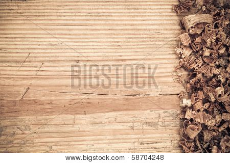 Wooden Board With Shavings Background