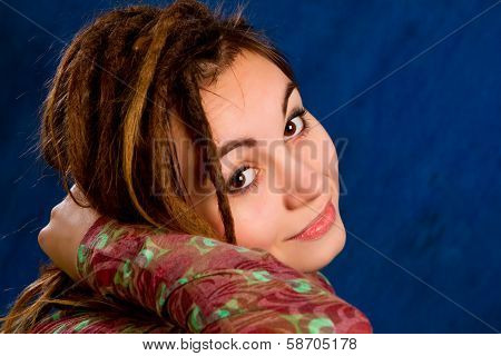 Young Woman With Dreadlocks Against  A Blue Background