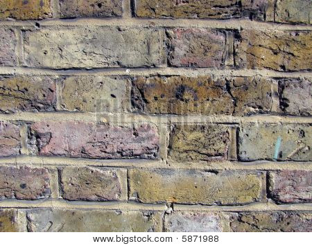 Weathered coloured urban brick wall, texture, background. poster