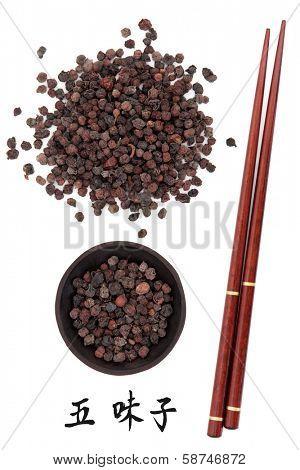Schisandra berries chinese herbal medicine with chopsticks and mandarin script title translation. Wu wei zi.