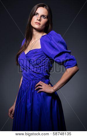 Beautiful brunette in long, blue dress