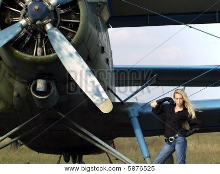 Young Woman Near Vintage Airplane