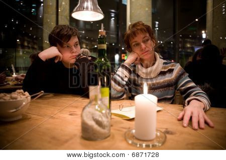 Woman With Her Son At Coffee Shop