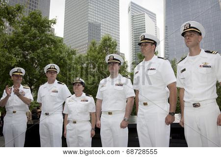 NEW YORK - MAY 23, 2014: Rear Admiral Scott A. Stearney applauds the naval officers promoted during the joint military services ceremony at the National September 11 Memorial site.