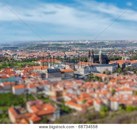 Aerial view of Hradchany part of Prague: the Saint Vitus Cathedral and Prague Castle, view from Petrin Observation Tower with tilt shift toy effect shallow depth of field. Prague, Czech Republic