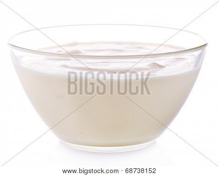 Glass bowl of yogurt isolated on white