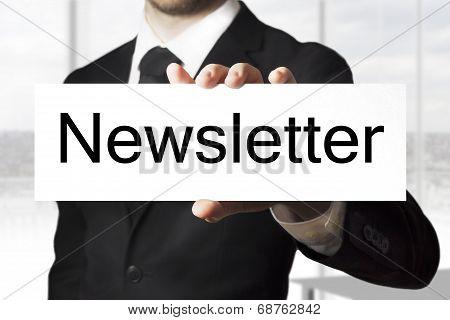 Businessman Holding Sign Newsletter