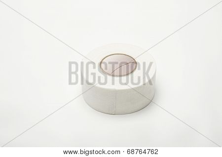 Roll of medical sticking plaster isolated over white background