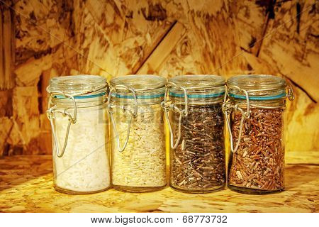 Foure Race Of Rice Varieties In Glass: Brown Rice, Mixed Wild Rice,jasmine Rice,rice Burry On Wood S