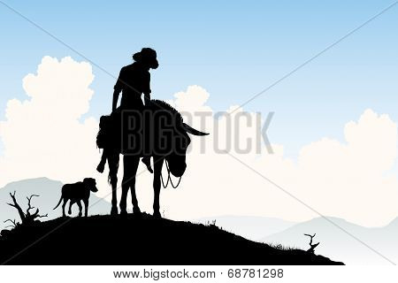 Editable vector silhouette of a weary traveler riding his donkey with dog following