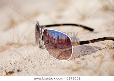 Sun Glasses Lie On Sand