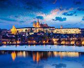 Travel Prague Europe concept background - view of Charles Bridge and Prague Castle in twilight. Prague, Czech Republic poster