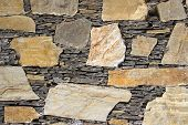 Beautiful mosaic of stones and slabs neatly stacked in wall poster