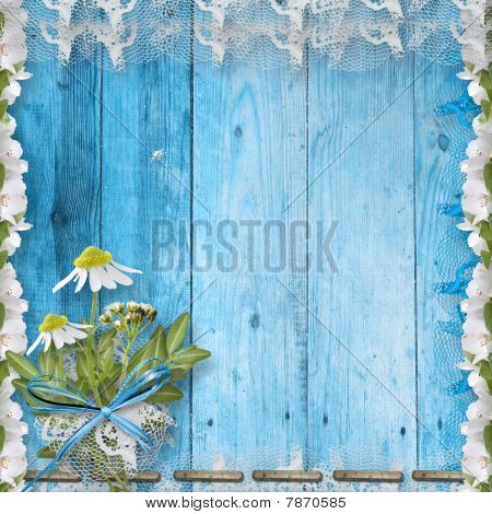 Grunge Wooden Wall With Bunch Of Flower And Lace